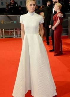 Satchel: Model Laura Bailey Wears Emilia Wickstead At The 2015 Baftas.
