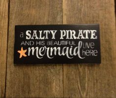 Description This hand painted sign reads a SALTY PIRATE AND HIS BEAUTIFUL mermaid live here. Size Measures approx 12 in x 5 1/2 in Made to order in 5 days. Colors background color- you can pick from 17 colors starfish color- you can pick from 4 colors lettering will be done in white Shipping We ship using Priority mail (2-3days) and comes with tracking and insurance. All of our signs are cut, sanded, painted and distressed by us. #Beachsigns