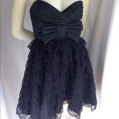 "Betsey Johnson 4 Strapless Lace Bow Party Dress Betsey Johnson 4 Strapless Lace Bow Party Dress in black. Excellent worn once condition. Side zip. Layered lace. Overall 28"" long. Bust is 16.5"" across, waist is 13.5"" laying flat. Fast shipping! Betsey Johnson Dresses"