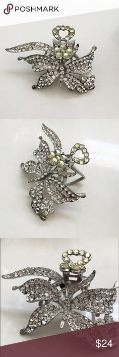 Rhinestone butterfly hair clip Never been used. Had it for a while and from moving one stone fell off but as showing in the third picture it can be easily fixed. Highlight it silver tone, or even add a sparkle of another rhinestone. NWOT Cache Accessories Hair Accessories