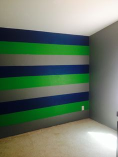 Just painted my 14 yr old son's room Seattle Seahawks colors! Sparkling Apple (Behr), Royal Breeze (Behr), and Cool Metalwork Grey (Glidden).
