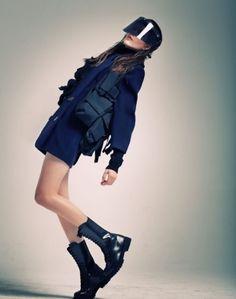 Futuristic Fashion, Future Fashion, Futuristic Style, sunglasses, legs, cyberpunk, future girl, futuristic girl, futuristic sunglasses,boots by FuturisticNews.com