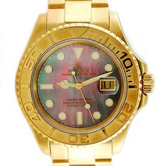 Rolex 18 Karat Yacht Master Rolex Yacht Master in 18 karat yellow gold with factory mother of pearl dial.