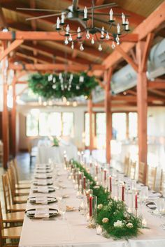 Greenery for wedding reception centerpiece, accented with candles and votives - very romantic for a summer wedding with greenery hung from the chandelier too! #weddingflowers #receptionideas #centerpieces #virginiaweddingflorist