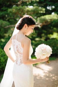 Bridal bouquet of ivory and blush pink peonies | Chicago Botanic Garden Wedding | Jenelle Kappe Photography