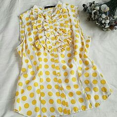 Ruffle front, button up blouse. Mustard yellow dots on a cream background. 100% silk.