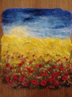 Felting Feast workshop at Diva Design Studio. Poppy field wet felted, with needle felted details added later, by one of our workshop participants - a first time felter!