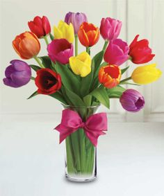 Easter Tulips! Capture the essence of spring with tulips, one of our most popular flowers! Colors may vary.