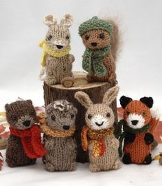 "Knitting Pattern for Wee Woodland Wuzzies - The pattern includes instructions for 6 animals: squirrel, mouse, hare, otter, hedgehog, and fox. The finished toys are approx. 3"" tall. The pieces are all knit flat, then seamed and assembled. The hat and scarf patterns are also included. Designed by Fuzzy Mitten"