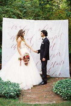 Ceremony Décor - Pick up a set of sheets or a tablecloth from the dollar store, and ask a friend who's good at calligraphy to write a meaningful quote or one of your vows on the sheet. This is such an easy way to add a personalized touch to your wedding for very little money!