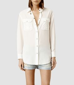 I like button down shirts and neutral colors, as well as shorts with relaxed shirts.