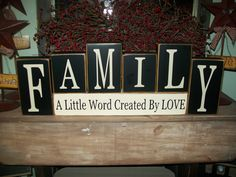 Primitive Family..A Little Word Created By Love Wood Sign Shelf Blocks Distressed Country Decor Stacking Letter Blocks. $39.99, via Etsy.