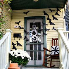 Delight Your Trick-or-Treaters with These 10 Easy D.I.Y.s - Front door bat barrage - Arrange daunting cutout black bats for a spooky and thrilling trick-or-treater greeting. This Halloween decoration is so simple to make, and can be stored and reused every year.