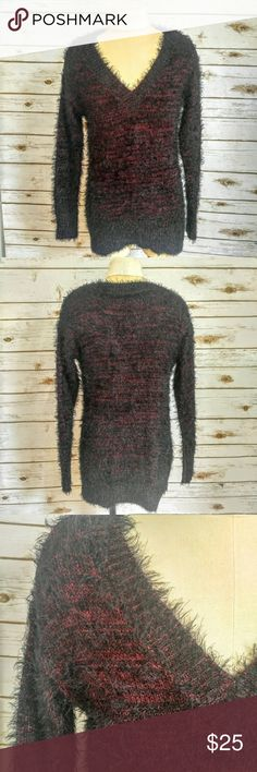 Rock & Republic Red and Black Soft VNeck Sweater Rock & Republic Red and Black Soft Metallic Vneck Sweater  Size S Red and black with metallic shimmer. Extremely soft and stretchy. 50% nylon 32% polyester 18% metallic Great condition with no flaws. Please let me know if you have any questions. I ship the same day as long as the post office is still open. Have a great day, thanks for checking out my closet and happy poshing! Rock & Republic Sweaters V-Necks