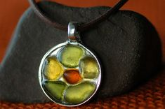 Bezel is silverplated not handmade, glass attached w resin