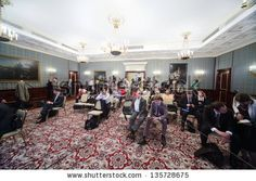 MOSCOW - APRIL 24: Newspapermans sit on Enlarged meeting of Council in Grand Kremlin Palace on April 24, 2012 in Moscow, Russia. - stock photo