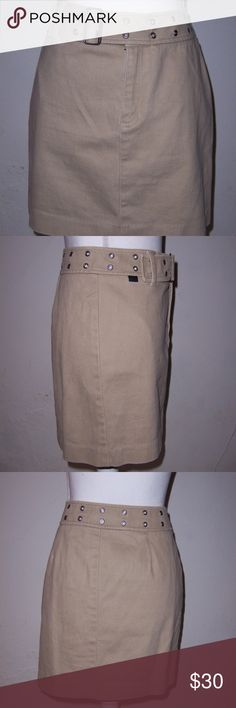 "Ralph Lauren Khaki Mini Skirt Belted Size 8 Women's khaki belted mini skirt  Ralph by Ralph Lauren brand  Size 8 100% soft cotton fabric is heavier in nature and has almost a denim feel  ""Belt"" built into waistband with off center buckle and metal grommets  Front zipper with metal slide closure and single interior plastic button  Measures about 17 inches long waist to hemline  Measures about 15 1/2 inches across or 31 inches around at the waist  Hips measure about 19 inches across or 38…"