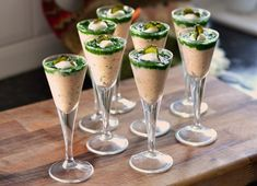 Salmon and crème fraiche shots topped with watercress purée and pickled cucumber
