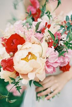 Natural Wedding Bouquets: Peach Peonies, Red Ranunculus, and Pink Stock | Brides.com