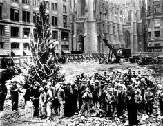 1931. Workmen begin a tradition. The first Christmas Tree at Rockefeller Center in New York City.