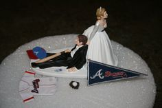 Hey, I found this really awesome Etsy listing at http://www.etsy.com/listing/53659498/atlanta-braves-wedding-cake-topper-groom