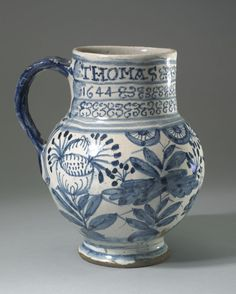 mug  Museum number  1960,0403.1 Description  Mug; tin-glazed earthenware; cylindrical neck and bulbous body tapering to small out-turned foot; decorated in blue on white with birds on rock amongst foliage on body; three bands of pattern; inscribed name and date; blue handle. Culture/period      Post-Medieval term details  Date      1644  Production place      Made in: Southwark     (Europe,British Isles,England,London,Southwark