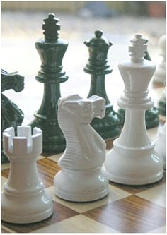 Classic Staunton solid wooden chess set. Nothing traditional about the gorgeous dark green and white gloss colour! Lovely! M3009. Brought to you by ChessBaron.co.uk