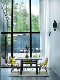 Yellow Eames chairs in a Swedish lake house - via My Scandinavian Home House Design, Scandinavian Home, Interior Design, House Interior, House, Home, Interior, My Scandinavian Home, Home Deco