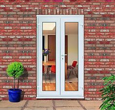 Small patio doors trompe loeil bring the outdoors in with exteria slim french doors planetlyrics Gallery