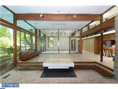 Stone and glass-walled sunken dining room with built-in planter? Yes! Bala Cynwyd, PA. Listing 6662974 courtesy of Keller Williams Main Line Realty.
