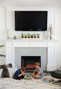Renter-Friendly Movable Faux Fireplace with TV over the Mantel