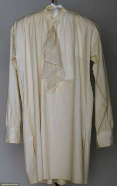 MAN'S WHITE LINEN SHIRT, AMERICA, c. 1800  Lot: 180 November 13, 2013 - NYC New York City V front w/ ruffles, fine linen w/ fold down collar, very good; t/w 1 cotton shirt w/ band collar & pleated bib, (bib on L side only) fair.   Price Realized: $ 1320.00 Category: Gents Era: 1800-1850 29.13482.240.180