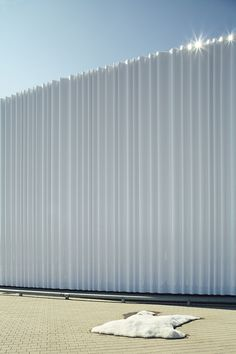Warehous in Vitra Campus by SANAA, Weil am Rhein, Germany The façade is clad with a continuous surface of white acrylic corrugated panels of three different types