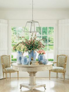 Bowers's library table is the center of attention in this sitting room. Swedish 18th-c. library table with 19th- and 20th-c. Chinese jars. French light fixture. Pair of 19th-c. fauteuils in vintage Fortuny fabric.   - Veranda.com