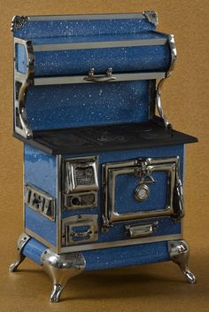 Reproduction Qualified Range Co. cast iron, enameled, and nickel toy stove, 21'' h., 12 1/2'' w