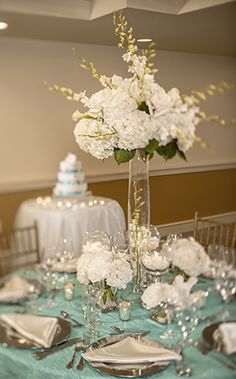 Transition the outdoors indoors with wedding reception decor such as hints of blue waves and a starfish or two