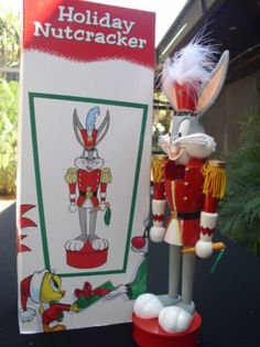 Bugs Bunny Soldier uniform Warner Brothers Nutcracker made of wood  Buggs is hold his carrot.  He is in his original packing and in the original box as you see him in this picture.The Size is approximately 14 inches tall. He seems to be in excellent condition. Avaolable at ToysbyStacy.com.
