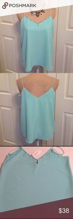 """NWT, Banana Republic, Aqua Blue Camisole NWT, Banana Republic, Aqua Blue fully lined Camisole. Stunning Camisole has single spaghetti straps with matching looped Strap along the front neckline. Made with machine washable Soft 97% Polyester & 3% Spandex fabric. Last pic shows the Double fabric Liner. Liner is Velvety Soft. ✅Chest 36"""", Waist tapers out with loose fit up to 40"""" and is 24"""" Long. Aqua Color Looks Fabulous under Black & Charcoal Grey Blazers, Jackets or Sweaters. Great piece to…"""