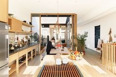 Studio Junction transformed a two-story apartment above Mjölk, Juli Daoust and John Baker's design boutique on Toronto's busy Dundas Street West, into a tranquil space. A courtyard joins the living room and the open kitchen and dining area.