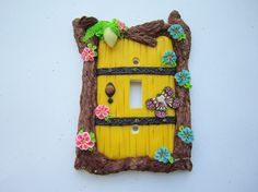 Fairy door light switch plate cover, spring flowers, birds nest, polymer clay, handmade by DawnsClayFantasy on Etsy