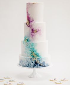 Watercolour wedding cake with gold leaf detail by Claire Owen Cakes. Photo by Claire Graham