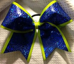 Blue and yellow cheer bow