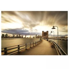 Depicting a view above the Holland tunnel looking at the Hudson River and a New Jersey skyline taken in New York City.