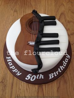 Musical themed birthday cake! Half piano and half guitar.