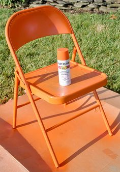 spray painted metal folding chair