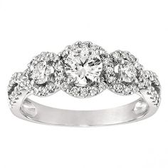 Three Stone Halo Pave Set Diamond Engagement Ring Setting- I love the circle cut diamonds and that its inset. I dont like stones that stick out from the ring.