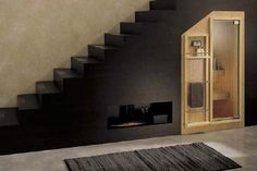 sauna under the stairs! I want this in my basement.
