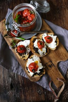 bruschetta with black olive tapenade, cream cheese and confit tomatoes.