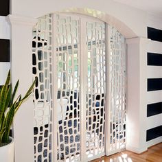 Interesting room separating doors, still allow air to flow.  Not crazy about the wall stripes, but love the doors!