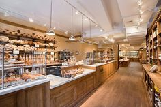Le Pain Quotidien is a Belgian bakery & casual dining experience designed in the style of French country home, with an ambiance that is reminiscent of your grandmother's dining table. Bakery Shop Interior, Bakery Shop Design, Patisserie Design, Cafe Interior Design, Coffee Shop Design, Cafe Design, Design Design, Cafe Restaurant, Restaurant Design